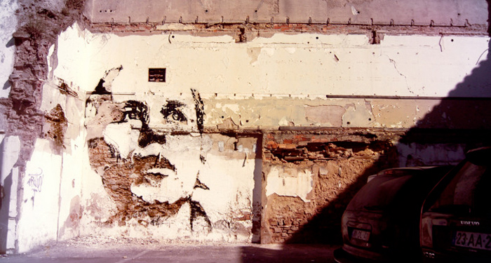 Vhils wall surface chipping